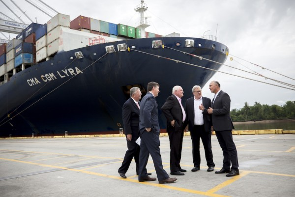 U.S. Secretary of Agriculture Sonny Perdue (center) Canadian Agriculture Minister Lawrence MacAulay (right center) and Mexican Secretary of Agriculture José Calzada Rovirosa (right) listen to Georgia Ports Authority Executive Director Griff Lynch (second from the left) during a tour of the Port of Savannah, Tuesday, June 20, 2017, in Savannah, Ga. (Georgia Ports Authority/Stephen B. Morton)