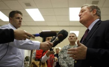 North Dakota Governor Jack Dalrymple (R) speaks with the media at the FEMA Disaster Recovery Center in Minot, North Dakota, June 27, 2011.