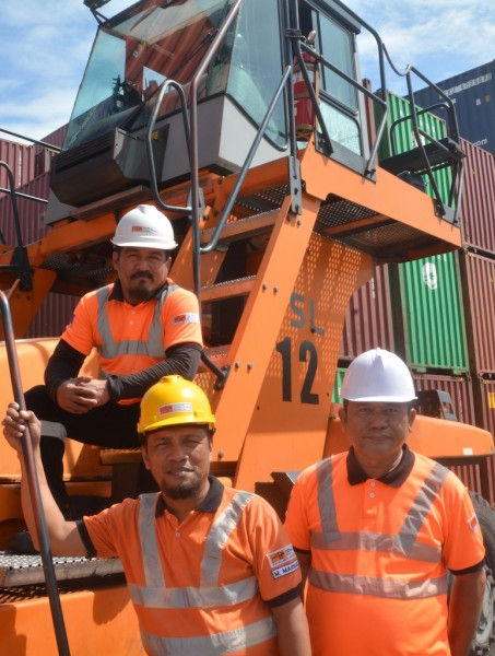 Model container handling equipment operators at ICTSI's flagship Manila International Container Terminal (from left): Alfredo Baysa, reach stacker; Manuel Maribojoc, prime mover; and Edwin Sintos, quay crane.