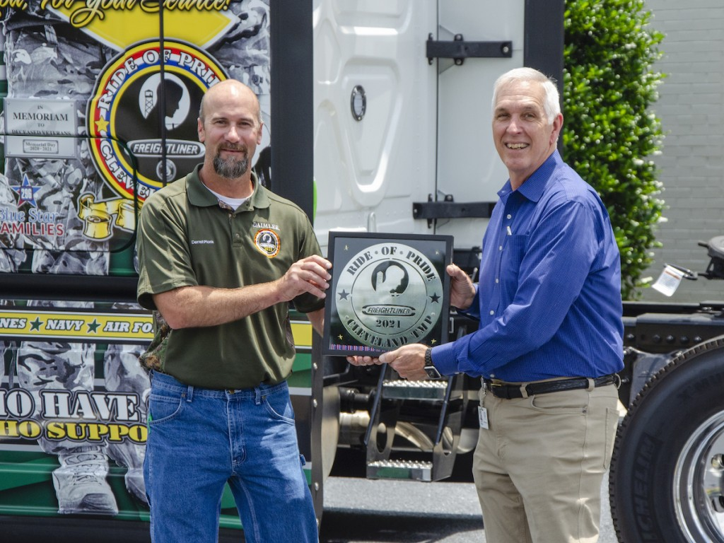 Darrell Plonk (L), Logistics Manager at Daimler Trucks' Cleveland, N.C. Freightliner plant, delivers the Ride of Pride tractor to Jim Raynor, Old Dominion Freight Line's Vice President of Maintenance and Equipment.