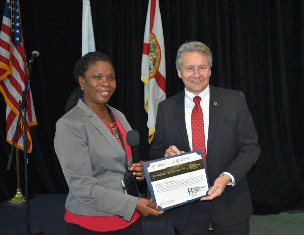 Port Canaveral CEO John Murray receives certificate of recognition from Jacqueline Emmanuel-Flood, CEO St. Lucia Trade Export Promotion Agency and ACE delegate