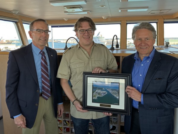 L -R Canaveral Port Authority Commissioner RDML Wayne Justice, Happy Dover Captain Willem Kloet, Port Canaveral CEO Captain John Murray (Photo: Canaveral Port Authority)
