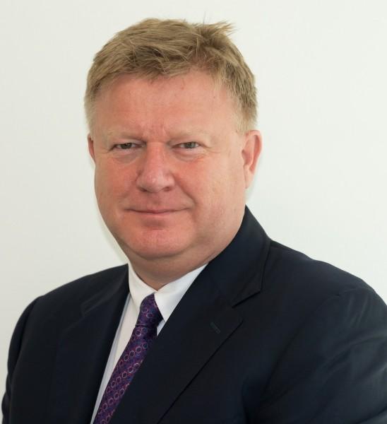 Mr. Neville Bissett - CEO of QTerminals