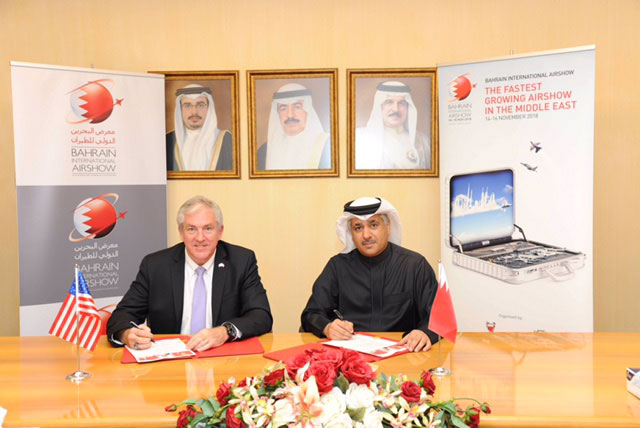 His Excellency, the Minister of Transportation and Telecommunications Engineer Kamal bin Ahmed Mohammed (r) and Kallman Worldwide President and CEO, Tom Kallman, formalized the agreement at a signing ceremony in Manama.