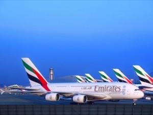 https://www.ajot.com/images/uploads/article/emirates-planes-at-terminals.jpg
