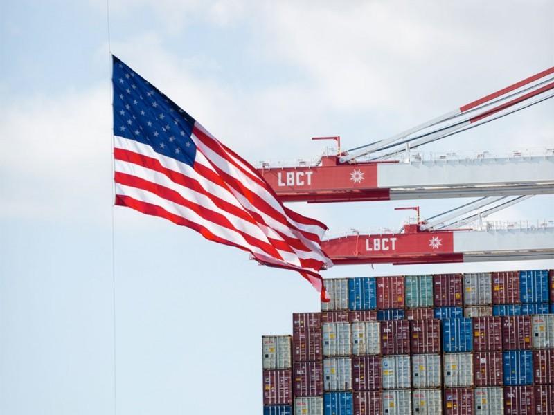 https://www.ajot.com/images/uploads/article/long-beach-container-cranes-us-flag.jpg