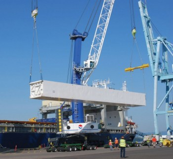 Linde cold box being hoisted by cranes at the Port of Vancouver USA