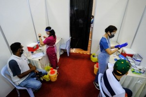 Slow vaccines for seafarers threaten to worsen shipping chaos