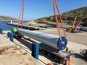 Cosmatos offloading and transportation of windmills in Greek Island