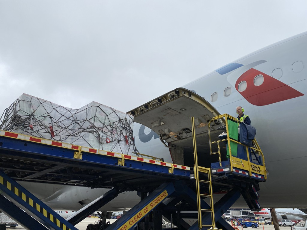 The COVID-19 vaccine doses are loaded into the cargo compartment of the Boeing 777-200 aircraft.