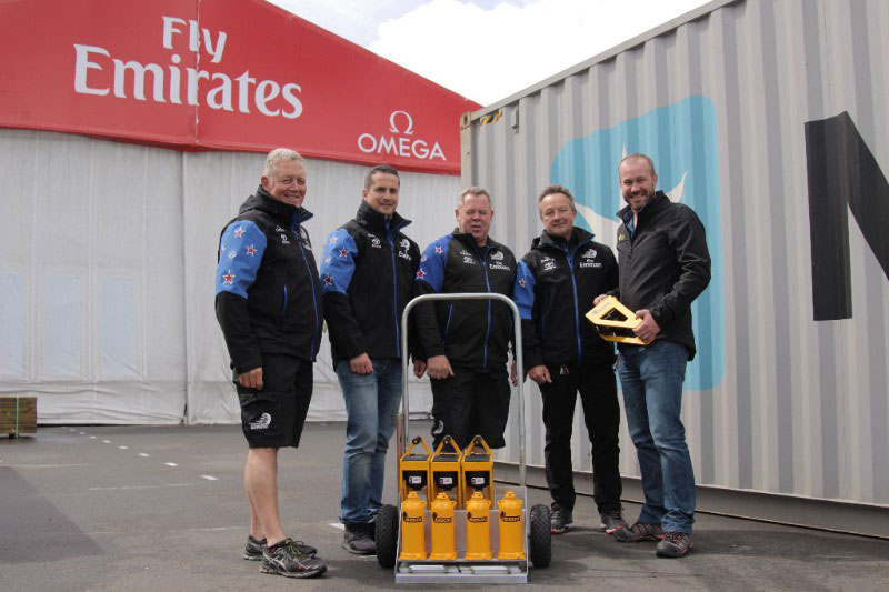 BISON CEO, Greg Fahey (right), delivering a set of BISON C-Jacks to ETNZ Logistics & Base Manager, Andy Nottage (2nd from right) and other ETNZ team members