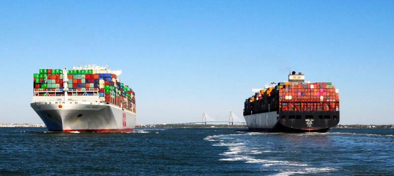 Two 13,000 TEU vessels, the OOCL Poland and UASC Jebel Ali, meet in the Charleston Harbor.