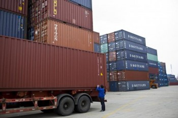 An employee takes notes at a port of Shanghai Free Trade Zone, February 11, 2014. Credit: Reuters/Aly Song