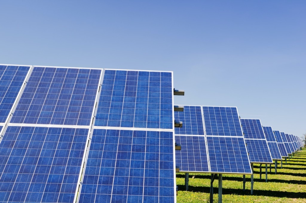 A worker inspects solar panels at a solar farm in Dunhuang, 950km (590 miles) northwest of Lanzhou, Gansu Province September 16, 2013. 26.