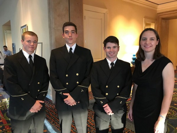 From left: Scholarship recipients Samuel Comerford, Alex Yonkman and Tyler Sayvetz with Crowley's Victoria Ellis (Not shown: Kent Treptow)