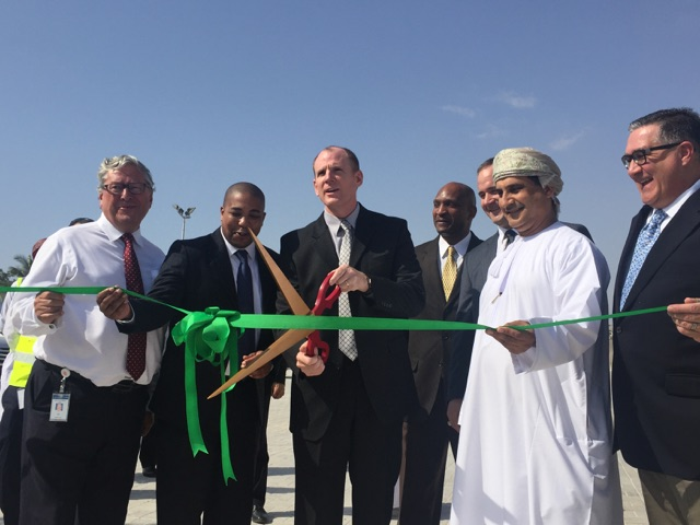 Partners and customers were on hand to help cut the ribbon on DLA's new material processing center, located on the Port of Salalah in Salalah, Oman. Those pictured include David Gledhill, Chief Executive Officer, Port of Salalah; Peter Boone, deputy commander, DLA Distribution Bahrain; Air Force Brig. Gen. Martin Chapin, commander, DLA Energy; Navy Capt. Terrel Fisher from DLA CENTCOM & SOCOM; Army Col. Eric Larson, defense attaché, U.S. Embassy Muscat; Hamdan Al Hinai, director of Procurement and Contracts, Office of the Secretary General, Ministry of Defence; and Paul McMillan, area manager, Kaiserslautern, DLA Disposition Europe.
