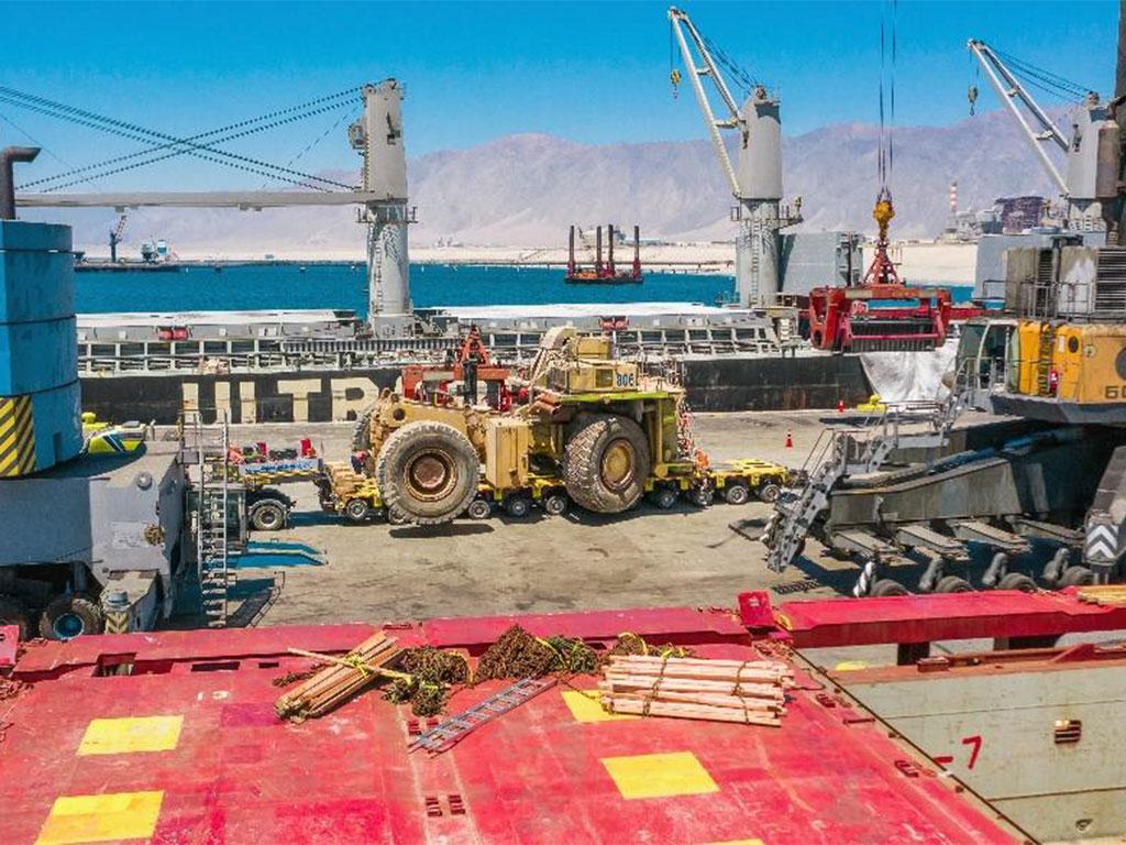 Shipment and project management of seven Komatsu 930E trucks from Puerto Angamos, Chile to Porto do Açu, Brazil
