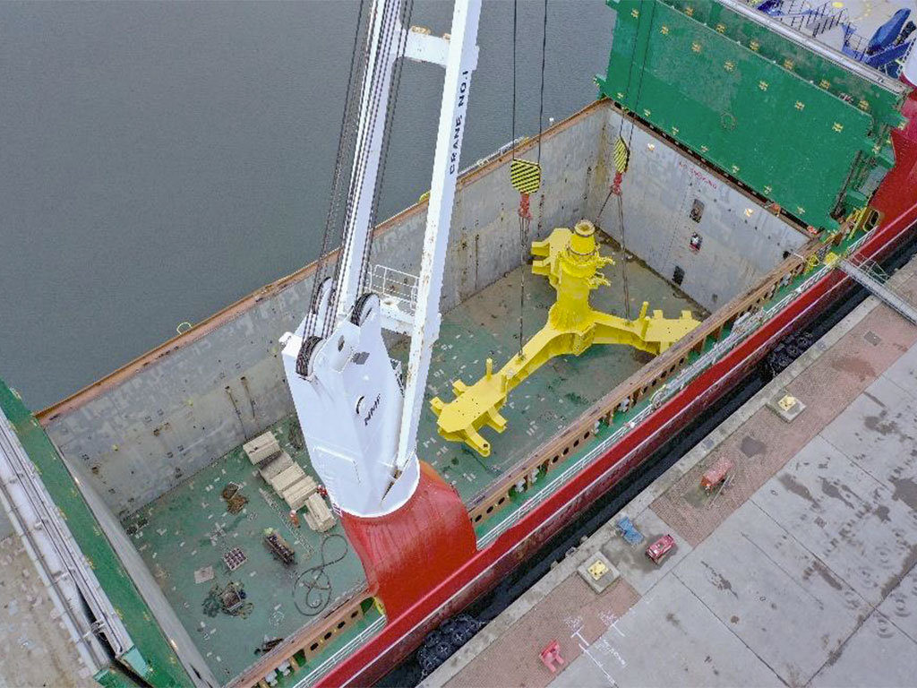 A 175 MT base foundation is loaded into hold number two of the MV Josef using the on-board cranes.