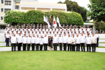 A commemorative shot of graduates with guests