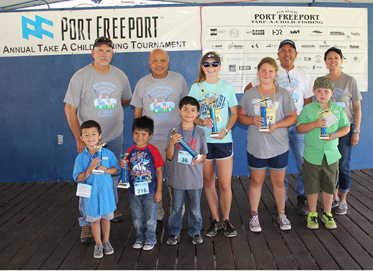 From left, Port Freeport Commissioners Shane Pirtle, Ravi Singhania, Rudy Santos and Executive Director/CEO Phyllis Saathoff present the 1st place through 3rd place awards to the tournament winners in the blue fins and yellow fins divisions.