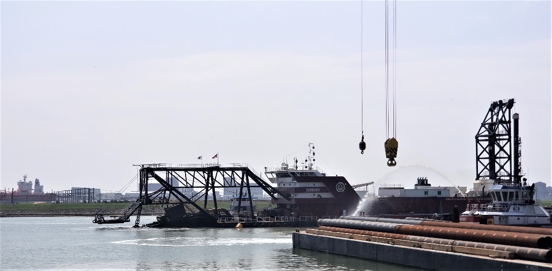 The Dredge Carolina cutterhead is lowered into the Freeport Harbor Channel