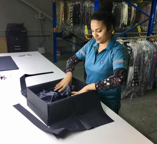 Alisha Dsouza, part of the stock handling team, packing orders for The Modist.