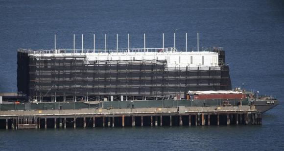 A barge built with four levels of shipping containers is seen at Pier 1 at Treasure Island in San Francisco, California October 28, 2013. How badly does Google want to keep under wraps a mysterious project taking shape on a barge in San Francisco Bay? Badly enough to require U.S. government officials to sign confidentiality agreements. Credit: Reuters/Stephen Lam