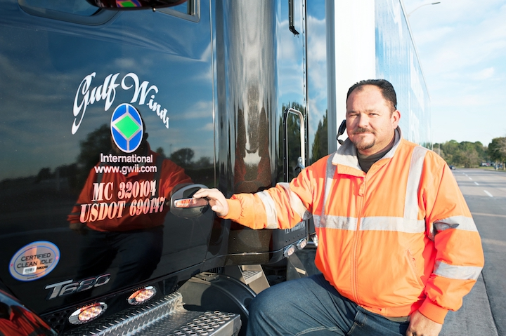 Jose Amezcua, one of about 400 owner-operators who drives for Gulf Winds International Inc., remains upbeat in a challenging Gulf drayage environment.