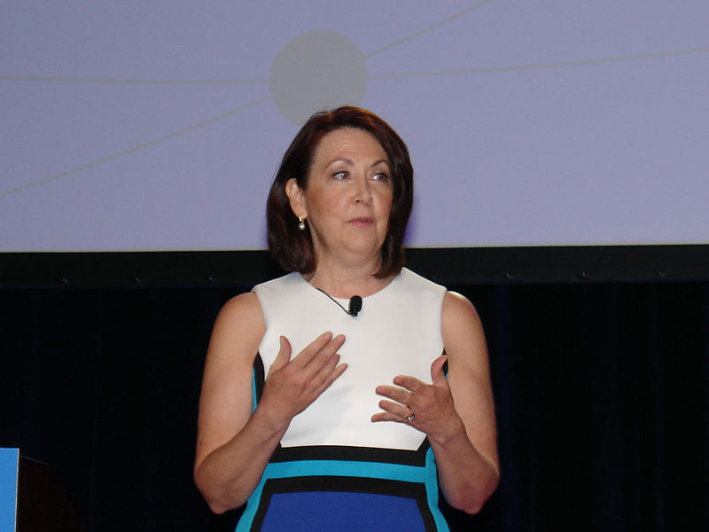 SMC3's Connections 2018 Chairwoman Heather Sheehan, executive director of Achieving Women's Excellence in Supply Chain Operations, Management and Education, delivers remarks. (Photo by Paul Scott Abbott, AJOT)