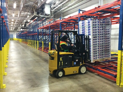 "A worker loads the first pallet of fresh Chilean table grapes into the new, state-of-the-art ""Box 5"" refrigerated storage facility at the Gloucester Marine Terminal in Gloucester City, NJ. The renovate facility was completed just in time for the start of the Chilean winter fruit season."