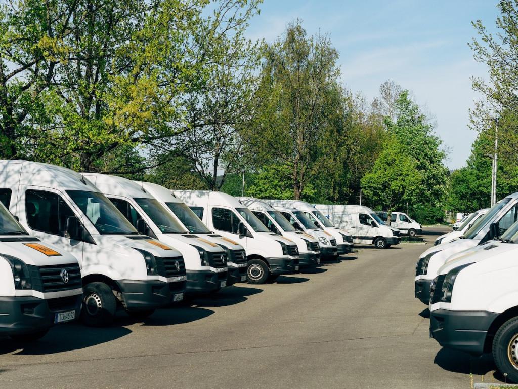 A fleet of white moving vans.