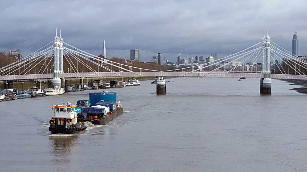 The first tunnel boring machine (TBM) is transported by Mammoet along the River Thames.
