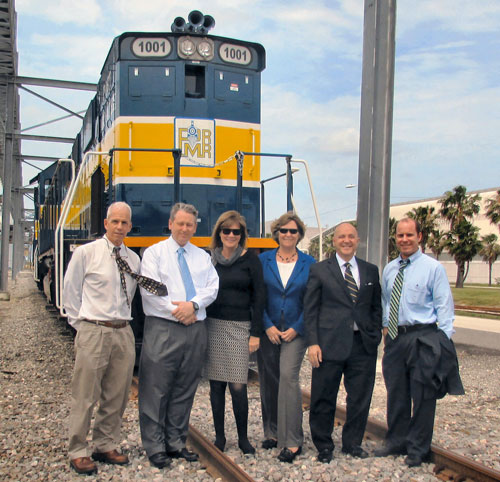 "Welcoming two new ""green"" locomotives to Port Manatee are, from left: John Chappie, first vice chairman, Manatee County Port Authority, Carl Warren, director of industrial development and ports, CSX Transportation; Carol Whitmore, chairman, Manatee County Port Authority; Betsy Benac, member, Manatee County Port Authority; Carlos Buqueras, executive director, Port Manatee; and Michael Gallen, second vice chairman, Manatee County Port Authority."