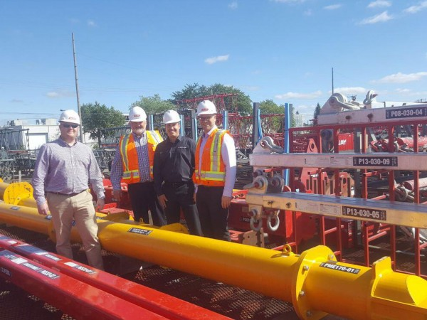 (left to right): Malcolm Peacock, of Modulift, with Jean-Louis Lapointe, of Guay Cranes, Luke Habza, of Equipment Corps, and Jean-Francois Houde, also of Guay.