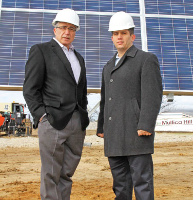 Fred Sorbello, left, president and chief executive officer of The Mullica Hill Group Companies, is joined by Jeremy Conner, chief executive officer of Mount Laurel, N.J.-based National Energy Partners LLC, at the groundbreaking for the world's largest dual-axis robotic solar field.