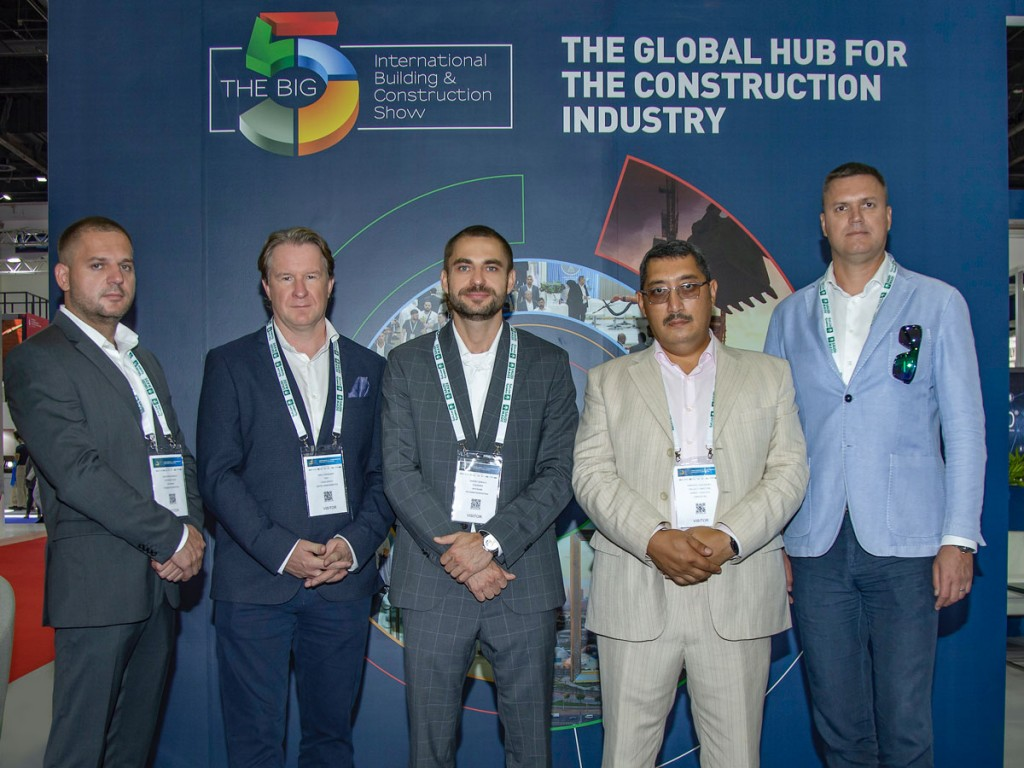 MYCRANE founder Andrei Geikalo, centre, is pictured at The Big 5 trade show, Dubai with his new franchise partners