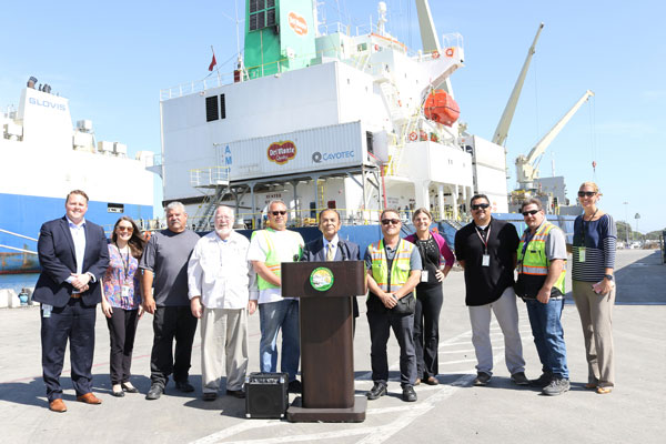 Oxnard Harbor Commissioner Jess Herrera (center), CEO & Port Director Kristin Decas, Craig Johnson of ENCOUNTER Bible Fellowship Church, Ramon Rios of Del Monte Fresh, Casey Dexter of Ports America, Warren Shelton of ILWU, and port staff celebrate the sending of two shipping containers to La Montana Christian Camp in Costa Rica.