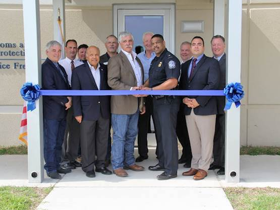 Port Commission and management join U.S. Customs and Border Protection cut the ribbon to the new CBP office with CBP Port Director for Houston/Galveston Seaports, Roderick Hudson.