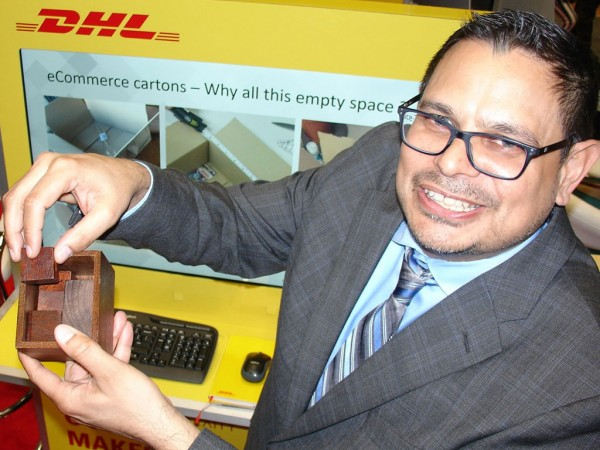 Adrian Kumar, vice president of solutions design for DHL Supply Chain, demonstrates carton optimization at the Retail Industry Leaders Association's LINK 2019 supply chain conference.
