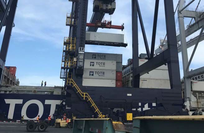 A large generator is offloaded from the Perla del Caribe on Oct. 7 in San Juan
