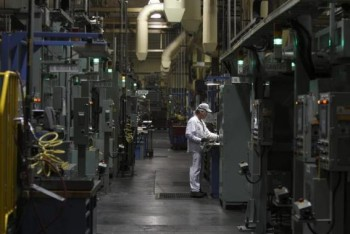 An associate is seen working in the connecting rod area during a tour of the Honda automotive engine plant in Anna, Ohio October 11, 2012.