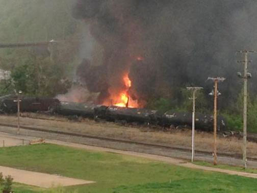 Flames are seen where a CSX Corp train carrying crude oil derailed and burst into flames in downtown Lynchburg, Virginia, April 30, 2014. Credit: REUTERS/WSET/Handout via Reuters